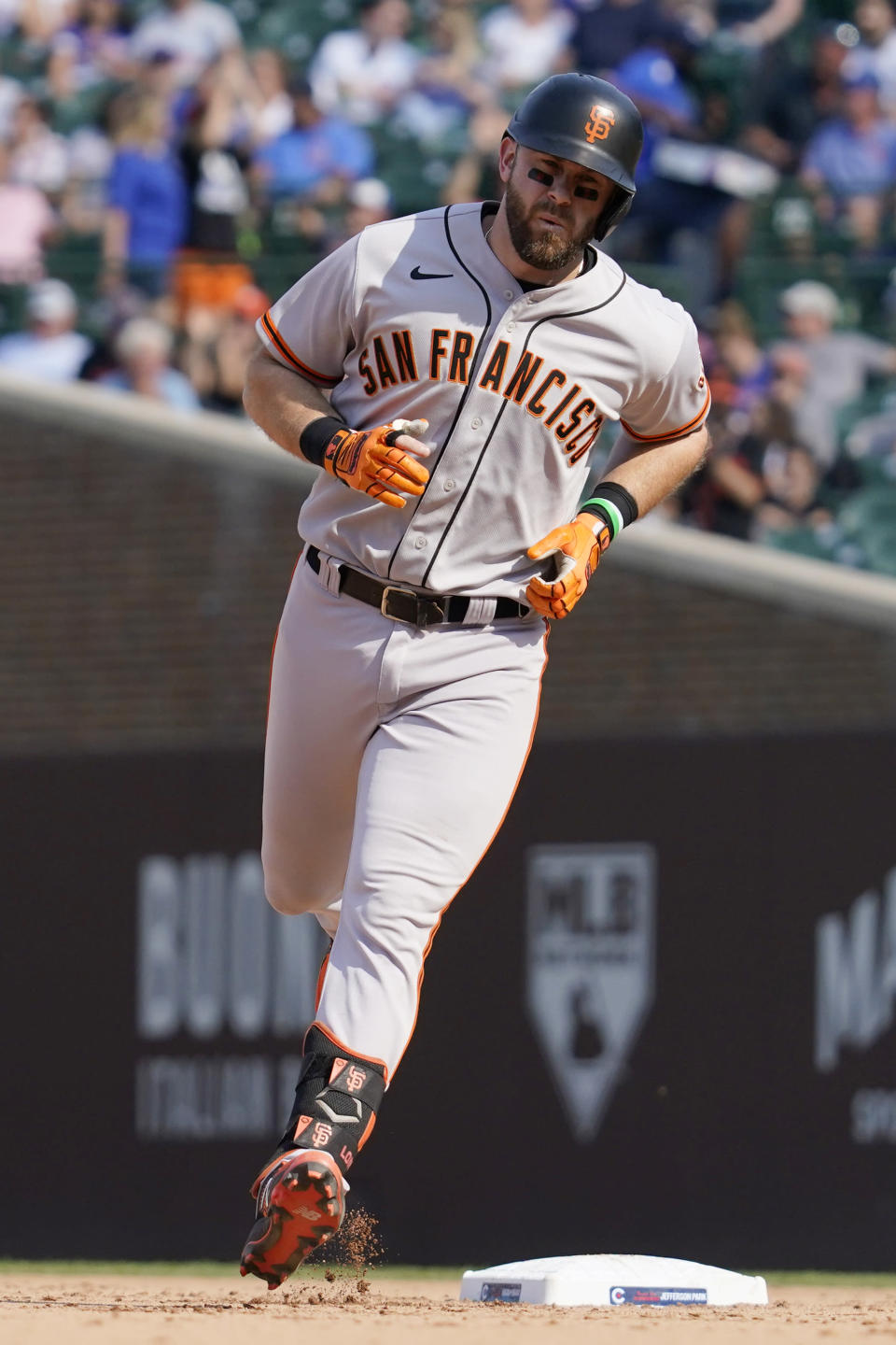 San Francisco Giants' Evan Longoria rounds the bases after hitting a two-run home run during the seventh inning of a baseball game against the Chicago Cubs in Chicago, Friday, Sept. 10, 2021. (AP Photo/Nam Y. Huh)