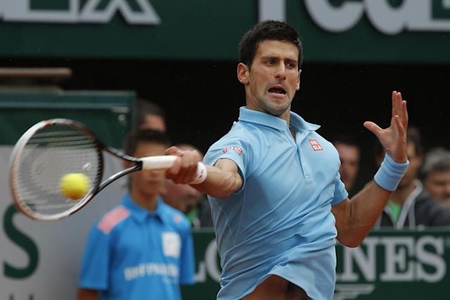 Serbia's Novak Djokovic returns the ball during the first round match of the French Open tennis tournament against Portugal's Joao Sousa at the Roland Garros stadium, in Paris, France, Monday, May 26, 2014. (AP Photo/Michel Euler)