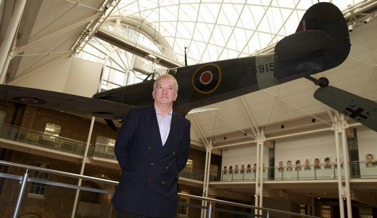 Project leader David Cundall stands in front of a Spitfire at the Imperial War Museum in London on November 28, 2012. The excavation team hunting for World War II-era Spitfires in Myanmar said Wednesday they were confident about recovering the planes after finding a crate buried in the ground