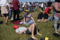 Hours before the start of the program, a supporter catches a nap before the start of former president Donald Trump's Save America rally in Perry, Ga., on Saturday, Sept. 25, 2021. (AP Photo/Ben Gray)