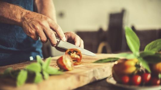 "<p>Sure, it's faster to order in Thai food or nuke a frozen meal than prep supper from scratch. But what you're gaining in time, you're losing in taste, nutrition, and good health. Studies show people who cook most of their meals at home are leaner, have <a href=""http://newsroom.heart.org/news/eating-more-homemade-meals-may-reduce-risk-of-type-2-diabetes?preview=cd73"" rel=""nofollow noopener"" target=""_blank"" data-ylk=""slk:less diabetes"" class=""link rapid-noclick-resp"">less diabetes</a>, and <a href=""http://www.jhsph.edu/research/centers-and-institutes/johns-hopkins-center-for-a-livable-future/news-room/News-Releases/2014/Study-Suggests-Home-Cooking-Main-Ingredient-in-Healthier-Diet.html"" rel=""nofollow noopener"" target=""_blank"" data-ylk=""slk:consume fewer calories"" class=""link rapid-noclick-resp"">consume fewer calories</a>, less sugar, and less fat overall — including on the nights they do dine out. Commit to cooking four dinners per week using fresh ingredients. It might seem daunting at first, but there are thousands of healthy, easy recipes online and creative ways to turn<a href=""http://www.mensjournal.com/expert-advice/transform-your-leftovers-into-meals-20150412"" rel=""nofollow noopener"" target=""_blank"" data-ylk=""slk:one night's leftovers into the next night's feast"" class=""link rapid-noclick-resp""> one night's leftovers into the next night's feast</a>.</p><p><i>(Photo Courtesy of Getty Images)</i><br></p><p><b><a href=""http://www.mensjournal.com/expert-advice/10-common-bad-habits-and-how-to-break-them-20150108?utm_source=yahoohealth&utm_medium=referral&utm_campaign=keepresolutions"" rel=""nofollow noopener"" target=""_blank"" data-ylk=""slk:Related: 10 Common Bad Habits and How to Break Them"" class=""link rapid-noclick-resp"">Related: <i>10 Common Bad Habits and How to Break Them</i></a></b></p>"