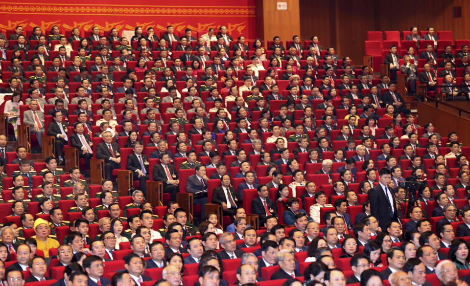 Delegates attend the opening of 13th Communist Party Congress in Hanoi, Vietnam on Tuesday, Jan. 26, 2021. Vietnam's ruling Communist Party has begun a crucial weeklong meeting in the capital Hanoi to set the nation's path for the next five years and appoint the country's top leaders. (Bui Lam Khanh/VNA via AP)