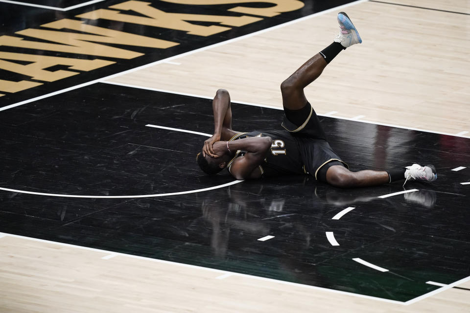 Atlanta Hawks' Clint Capela falls to the court after being hit during the second half against the Milwaukee Bucks in Game 4 of the NBA basketball Eastern Conference finals Tuesday, June 29, 2021, in Atlanta. (AP Photo/Brynn Anderson)
