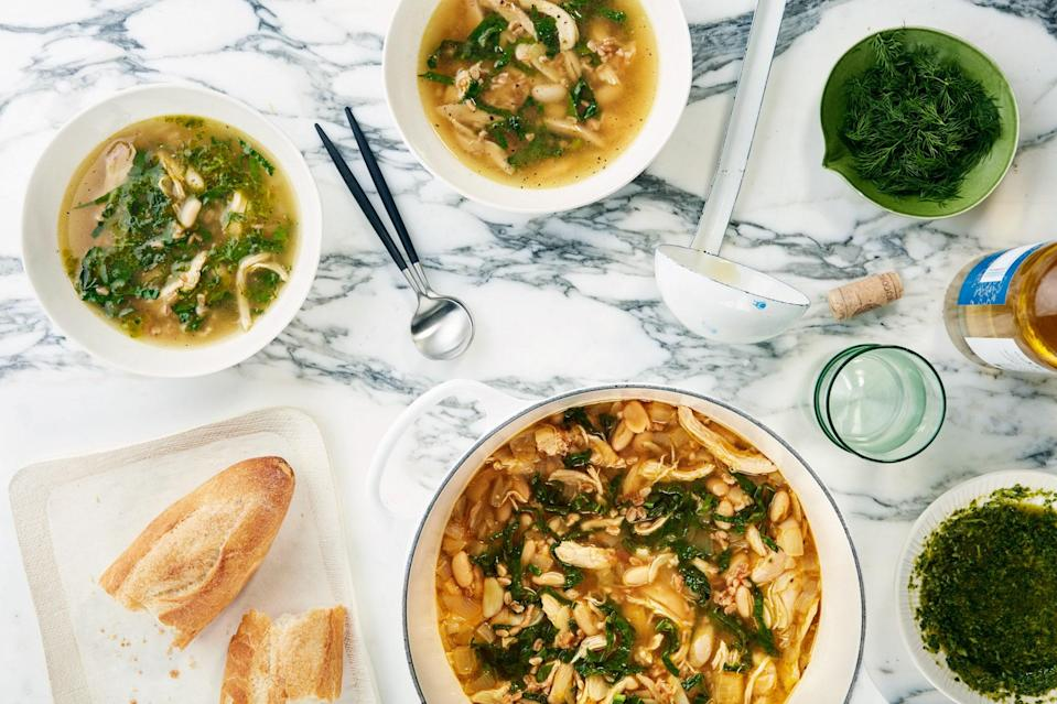 """For an extra burst of flavor, swirl some salsa verde into each serving of this hearty soup, which is packed with farro, white beans, kale, and plenty of lemon. <a href=""""https://www.epicurious.com/recipes/food/views/lemony-chicken-soup-with-farro-white-beans-and-kale?mbid=synd_yahoo_rss"""" rel=""""nofollow noopener"""" target=""""_blank"""" data-ylk=""""slk:See recipe."""" class=""""link rapid-noclick-resp"""">See recipe.</a>"""