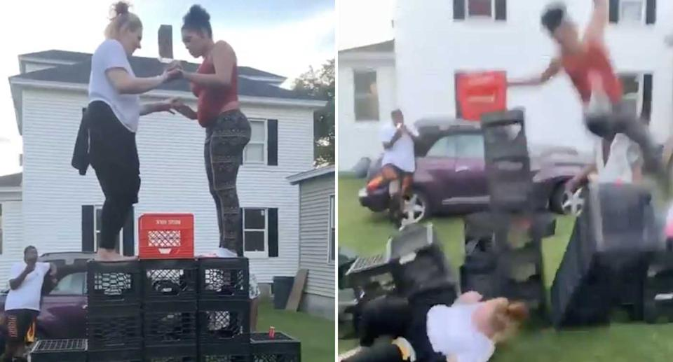 Two women fall off milk crates during the milk crate challenge.