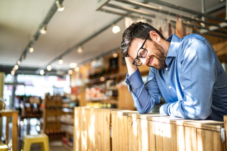 Worried small business owner