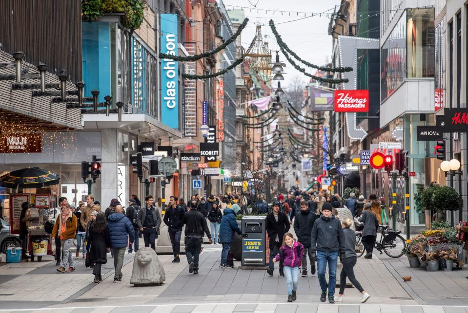 People stroll at the Drottninggatan shopping street in central Stockholm on November 10. Source: Getty