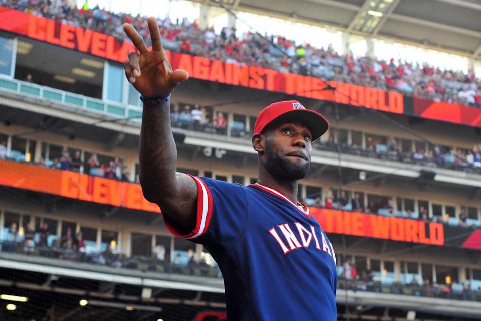 CLEVELAND, OH - OCTOBER 7, 2016: Forward LeBron James #23 of the Cleveland Cavaliers walks onto the field to address the crowd prior to Game 2 of the American League Division Series between the Boston Red Sox and Cleveland Indians on October 7, 2016 at Progressive Field in Cleveland, Ohio. Cleveland won 6-0.  164_0001 2016 Nick Cammett/Diamond Images/Getty Images