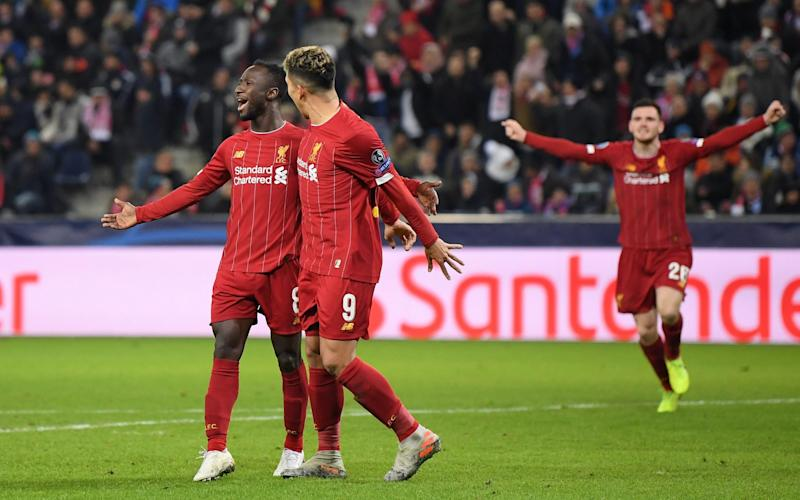Naby Keita of Liverpool celebrates with Roberto Firmino after he scores his team's first goal during the UEFA Champions League group E match between RB Salzburg and Liverpool - Getty Images Europe