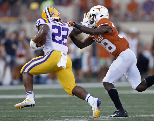 LSU Tigers running back Clyde Edwards-Helaire #22 tries to shake the tackle of Texas Longhorns defensive back Kobe Boyce #38, Saturday Sept. 7, 2019 at Darrell K Royal-Texas Memorial Stadium in Austin, Tx. ( Photo by Edward A. Ornelas )