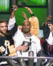 "FILE - DMX, center, accepts the R&B Album Artist of the Year during the 1999 Billboard Music Awards in Las Vegas, on Dec. 8, 1999. The family of rapper DMX says he has died at age 50 after a career in which he delivered iconic hip-hop songs such as ""Ruff Ryders' Anthem."" A statement from the family says the Grammy-nominated rapper died at a hospital in White Plains, New York, ""with his family by his side after being placed on life support for the past few days. He was rushed to a New York hospital from his home April 2. (AP Photo/Laura Rauch, File)"