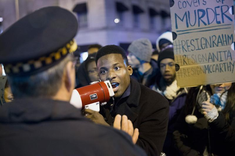 Demonstrators confront police during a protest over the death of Laquan McDonald on November 25, 2015 in Chicago, Illinois. (Photo: Scott Olson/Getty Images)