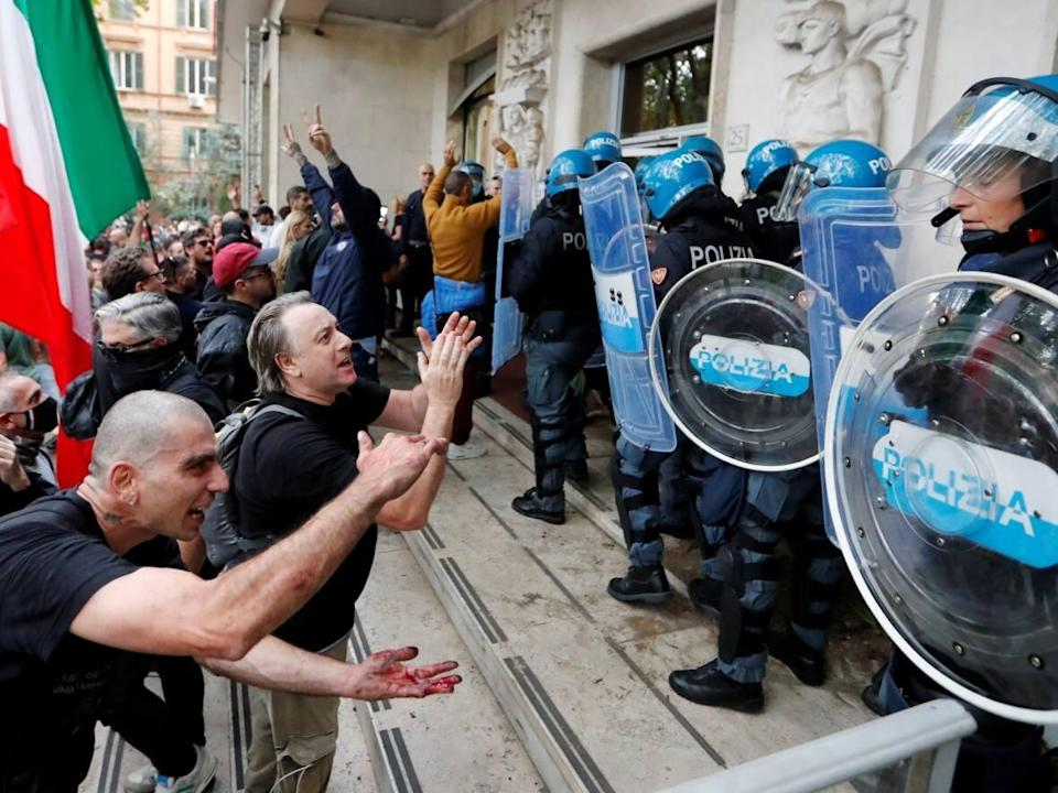 Demonstrators in Rome face off with police during an Oct. 9 protest against the Italian government's strict new COVID-19 green pass rules for workplaces. (Remo Casilli/Reuters - image credit)