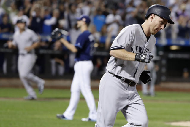 New York Yankees' Todd Frazier, right, runs past Tampa Bay Rays starting pitcher Jake Odorizzi after hitting a three-run home run during the fourth inning of a baseball game, Monday, Sept. 11, 2017, in New York. (AP Photo/Frank Franklin II)