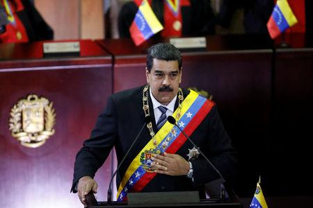 Venezuela's President Nicolas Maduro gestures as he speaks during a ceremony to mark the opening of the judicial year at the Supreme Court of Justice (TSJ) in Caracas, Venezuela February 14, 2018. REUTERS/Marco Bello
