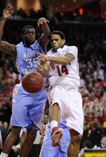 North Carolina guard Reggie Bullock (35) fights for the ball against Maryland guard Sean Mosley (14) during the second half of an NCAA college basketball game, Saturday, Feb. 4, 2012, in College Park, Md. North Carolina won 83-74. (AP Photo/Nick Wass)
