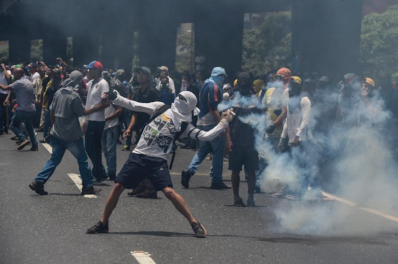 """Marchers in Caracas were forced back by lines of soldiers and police deployed to contain what the opposition vowed would be the """"mother of all protests"""""""