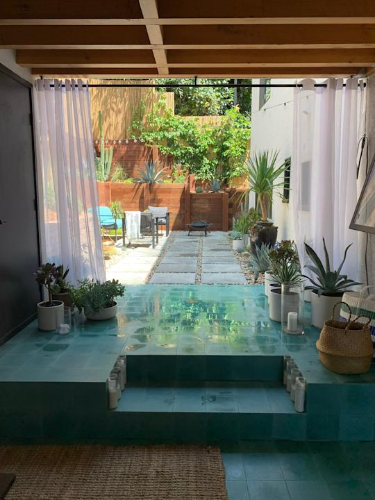 """<div class=""""caption""""> With James moving to Los Angeles, the team got the chance to break from their usual East Coast designs. """"L.A. helped us try some warmer, more tropical ideas,"""" says James. This green-tiled indoor/outdoor space is great for storing plants and even doing some indoor watering. </div> <cite class=""""credit"""">Photography: Michael Clifford</cite>"""