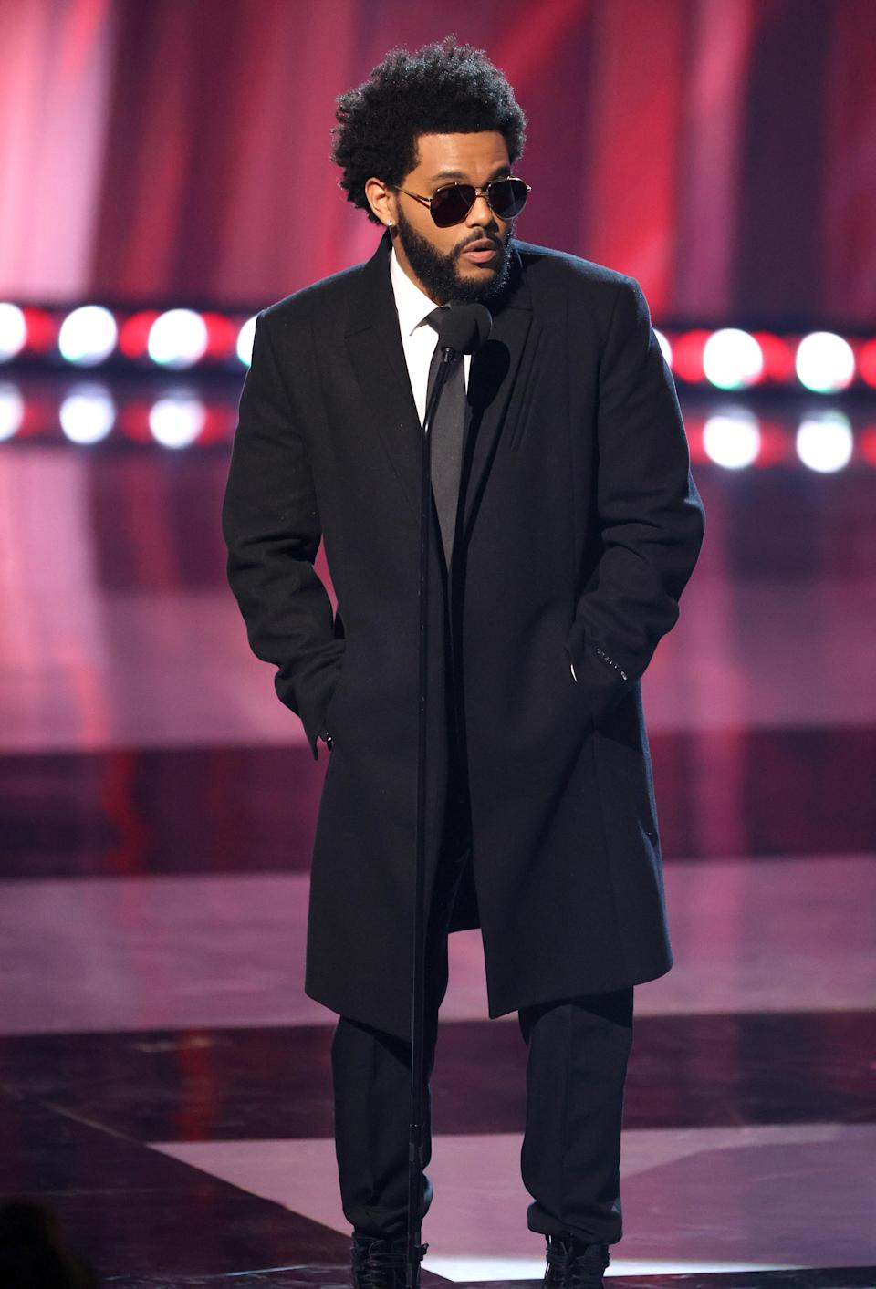 The Weeknd is the king of mystery so it's only right that he'd wear all black with tinted shades to match.