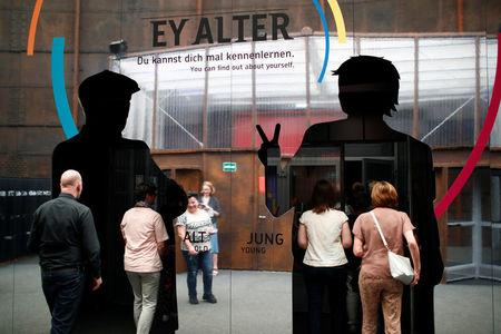 People visit an exhibition about demografic change called 'Ey Alter' by carmaker Mercedes Benz in Berlin