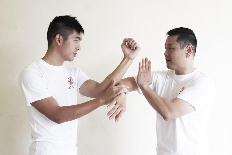 Wing Chun Instructors Daryl Yeo (left) and Michael Goutama (right) doing the Chi Sau; sticky hands. (Image Credit: Emily Mok)
