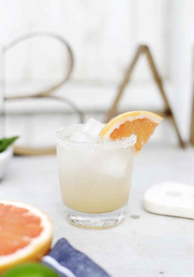 """<p>Like a Paloma, but dare way say better? Fresh grapefruit juice gives this virgin drink a zesty kick that's perfectly balanced with a splash of honey simple syrup.  </p><p><a class=""""body-btn-link"""" href=""""https://themerrythought.com/recipes/grapefruit-honey-spritzer/"""" target=""""_blank"""">GET THE RECIPE</a></p>"""