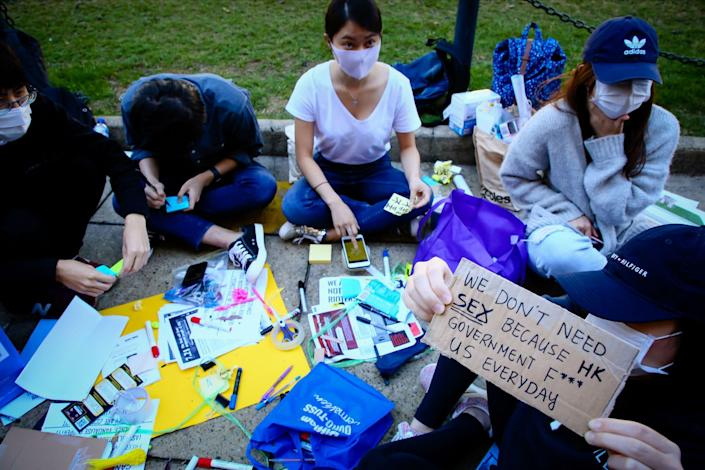 Supporters of the Hong Kong pro-democracy protests writing out sticky notes for a Lennon Wall in 2019.