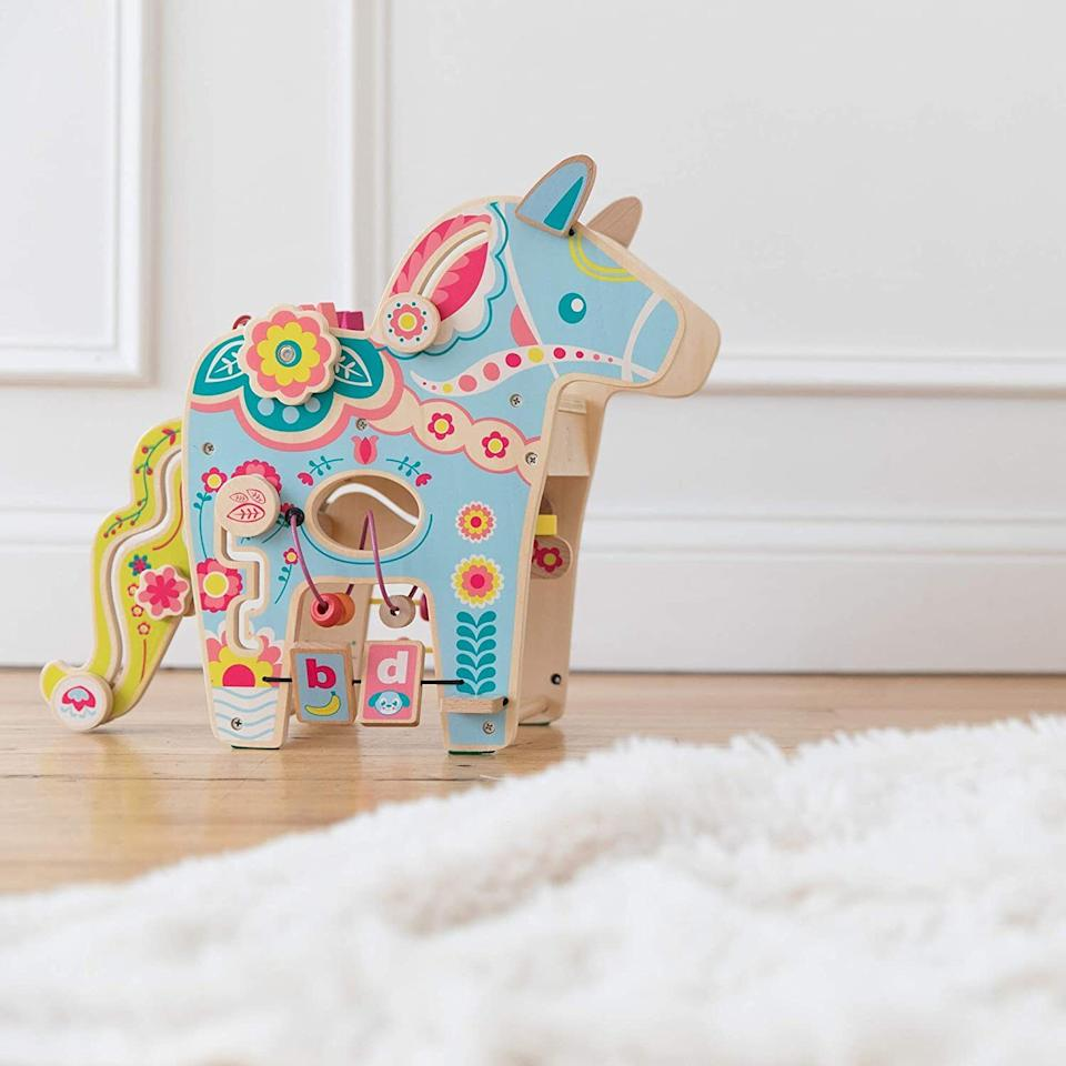 """With flapping ears, gliders, spinning dials, bead runs, a shape sorter and letter recognition, this activity center will make total horse sense for your toddler (and keep them occupied for anexorbitant amount of time).<br /><br /><strong>Promising review:</strong>""""This keeps my son entertained for quite a while.<strong>Good for developing motor skills.</strong>It also looks like a Dala horse, which is a symbol of our Swedish heritage. Very cute and fun toy."""" —<a href=""""https://amzn.to/2QnCwcp"""" target=""""_blank"""" rel=""""noopener noreferrer"""">Larissa</a><br /><strong><br />Get it from Amazon for<a href=""""https://amzn.to/3nnh8QN"""" target=""""_blank"""" rel=""""noopener noreferrer"""">$61.59</a>.</strong>"""