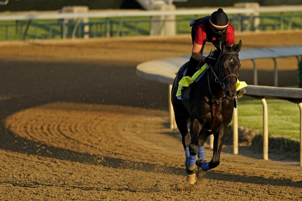 Kentucky Derby hopeful Medina Spirit works out at Churchill Downs Tuesday, April 27, 2021, in Louisville, Ky. The 147th running of the Kentucky Derby is scheduled for Saturday, May 1. (AP Photo/Charlie Riedel)