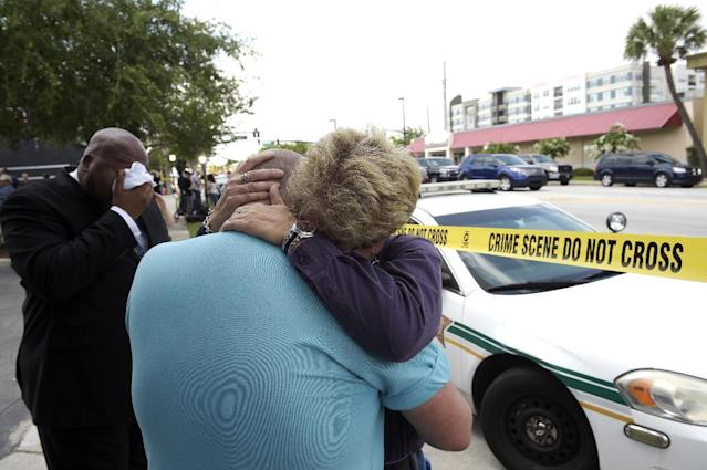 <p>Terry DeCarlo, executive director of the LGBT Center of Central Florida, center, is comforted by Orlando City Commissioner Patty Sheehan, right, after a shooting involving multiple fatalities at a nightclub in Orlando, Fla., June 12, 2016. (AP Photo/Phelan M. Ebenhack) </p>