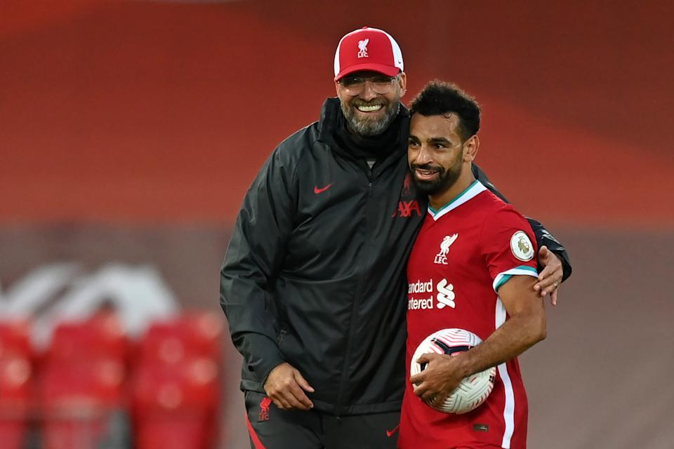 Jurgen Klopp (left), Mohamed Salah and Liverpool beat Leeds on Saturday. But was the close call a sign of troubles to come? (Photo by SHAUN BOTTERILL/POOL/AFP via Getty Images)