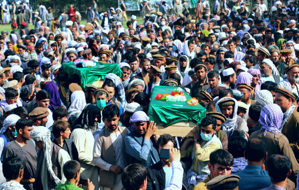 Afghans carry the body of civilians killed during fighting between the Taliban and Security forces, during their funeral, in Badakhshan province, northern Afghanistan, Sunday, July 4, 2021. Officials said Sunday that the Taliban's march through northern Afghanistan has gained momentum with the capture of several districts from fleeing Afghan forces. They said that several hundred of them fled across the border into Tajikistan.(AP Photo/Nazim Qasmy)