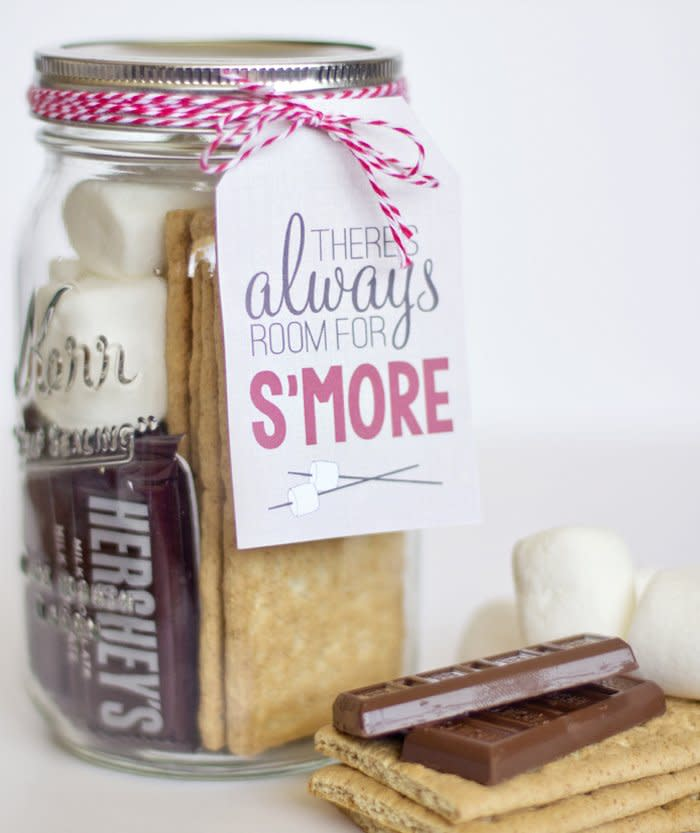 """<p>Nothing beats making s'mores with loved ones around an open fire. This season, bring it all together with these <a href=""""https://www.yellowblissroad.com/smores-gift-tags/"""" target=""""_blank"""">s'more mason jars</a> from Yellow Bliss Road. With all the materials to craft the ultimate s'more, you'll be giving the perfect gift and sweet treat all in one.</p>"""