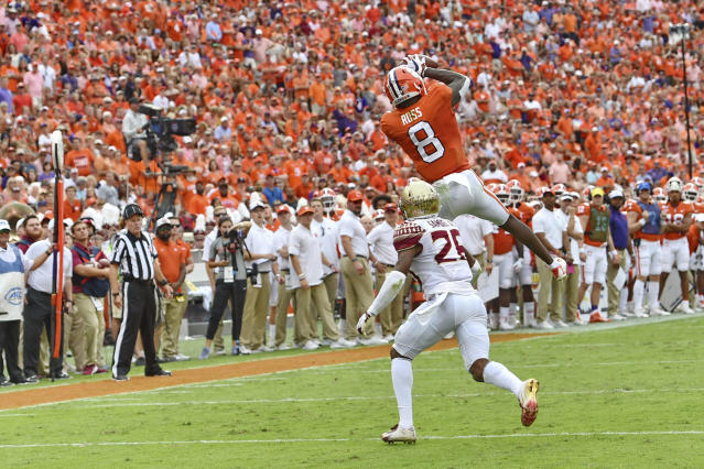 Clemson's Justyn Ross catches a pass over Florida State's Asante Samuel Jr. during the first half of an NCAA college football game Saturday, Oct. 12, 2019, in Clemson, S.C. (AP Photo/Richard Shiro)