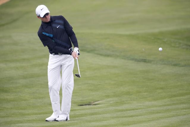 Simon Dyson of England chips on the the 7th hole during the second round of the BMW Masters golf tournament at the Lake Malaren Golf Club in Shanghai, China, Friday, Oct. 25, 2013. (AP Photo/Eugene Hoshiko)