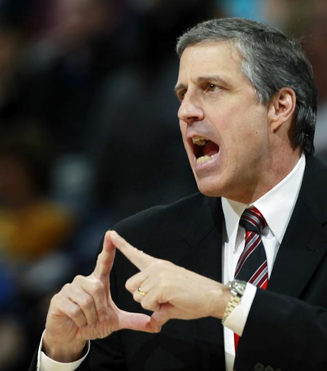Washington Wizards head coach Randy Wittman ends in a play as the Wizards face the Denver Nuggets in the first quarter of an NBA basketball game in Denver on Sunday, March 23, 2014. (AP Photo/David Zalubowski)