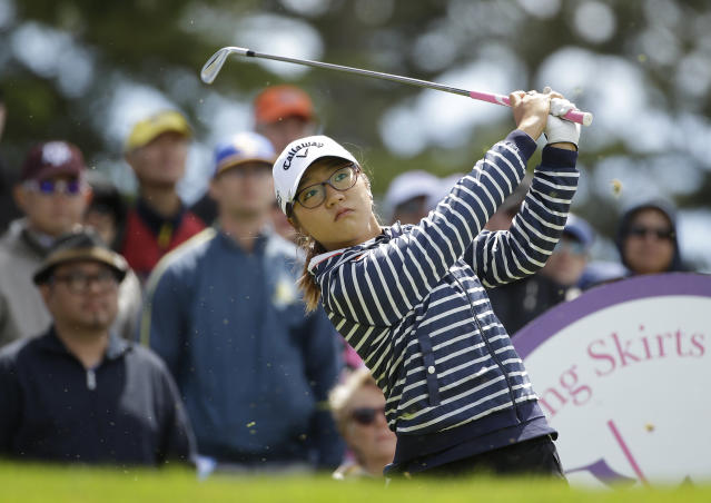 Lydia Ko, of New Zealand, follows her shot from the third tee of the Lake Merced Golf Club during the third round of the Swinging Skirts LPGA Classic golf tournament on Saturday, April 26, 2014, in Daly City, Calif. (AP Photo/Eric Risberg)