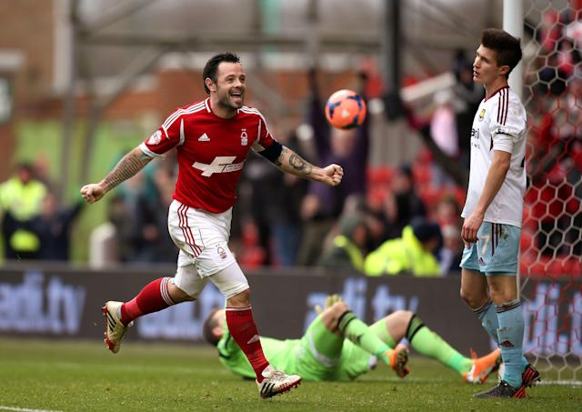 Nottingham Forest's Andy Reid celebrates scoring against West Ham United during the English FA Cup third round soccer match at the City Ground, Nottingham, England, Sunday Jan. 5, 2014. Nottingham Forest won the match 5-0. (AP Photo/PA, John Walton)