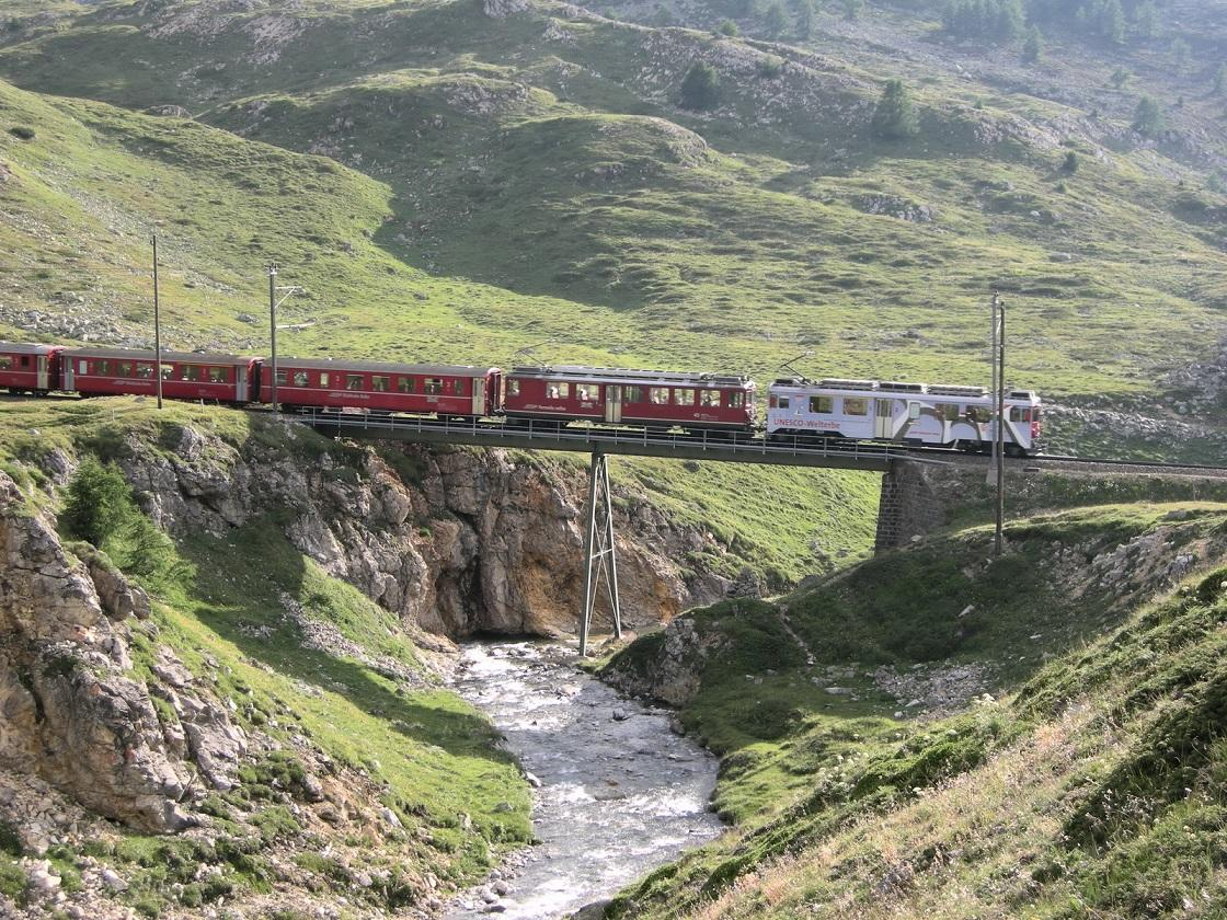 <p>Glide past blue lakes, snowy mountains and huge viaducts from behind panoramic windows on what's believed to be the steepest railway journey in the world. [Photo: Flickr/mstefano80] </p>