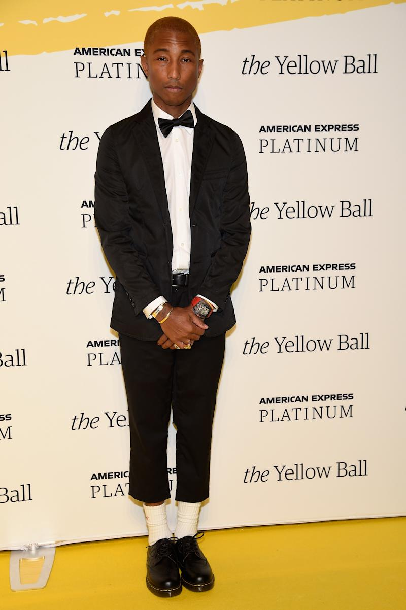 Pharrell Williams poses on the Yellow carpet at the Yellow Ball, hosted by American Express and Pharrell Williams, at the Brooklyn Museum on September 10, 2018, in New York, New York.