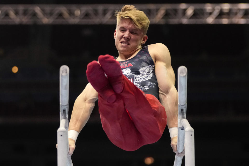Shane Wiskus competes on the parallel bars during the men's U.S. Olympic Gymnastics Trials Saturday, June 26, 2021, in St. Louis. (AP Photo/Jeff Roberson)