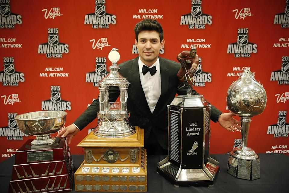 Carey Price of the Montreal Canadiens poses with, from left, the William M. Jennings trophy, the Vezina Trophy, the Ted Lindsay Award trophy and the Art Ross trophy after winning the awards at the NHL Awards show Wednesday, June 24, 2015, in Las Vegas. (AP Photo/John Locher)