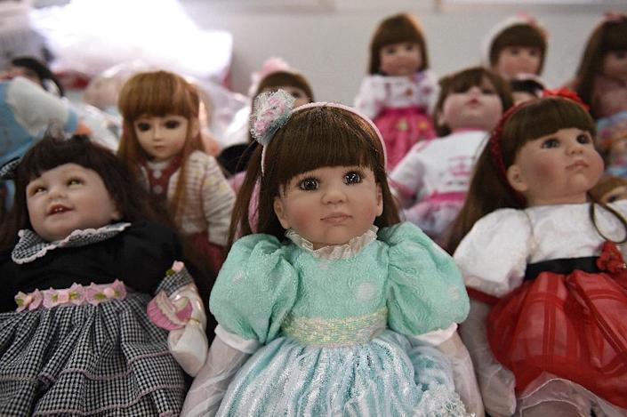 """Known in Thai as """"luuk thep"""" (child angels), the pricey dolls were first popularised by celebrities who claimed dressing up and feeding the dolls had brought them professional success (AFP Photo/Christophe Archambault)"""