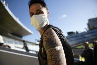 Soccer player Fabian Estoyanoff waits in observation after getting a shot of the Sinovac vaccine for COVID-19 at Centenario Stadium in Montevideo, Uruguay, Thursday, May 6, 2021. (AP Photo/Matilde Campodonico)