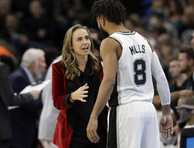"<a class=""link rapid-noclick-resp"" href=""/nba/teams/sas"" data-ylk=""slk:San Antonio Spurs"">San Antonio Spurs</a> assistant coach Becky Hammon was promoted Wednesday to the role once held by former Spurs assistant James Borrego. (AP Photo)"