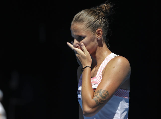 Karolina Pliskova of the Czech Republic reacts after defeating United States' Serena Williams in their quarterfinal match at the Australian Open tennis championships in Melbourne, Australia, Wednesday, Jan. 23, 2019. (AP Photo/Kin Cheung)