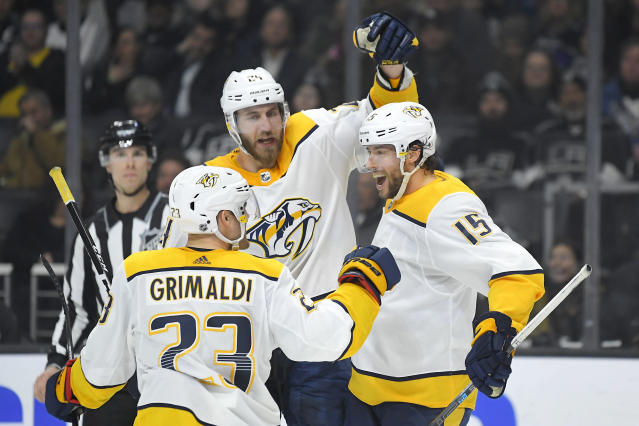 Nashville Predators right wing Craig Smith, right, celebrates his goal with right wing Rocco Grimaldi, left, and defenseman Jarred Tinordi during the third period of an NHL hockey game against the Los Angeles Kings on Saturday, Jan. 4, 2020, in Los Angeles. The Predators won 4-1. (AP Photo/Mark J. Terrill)