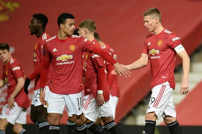 Manchester United midfielder Scott McTominay (right) celebrates after scoring against Watford in the FA Cup