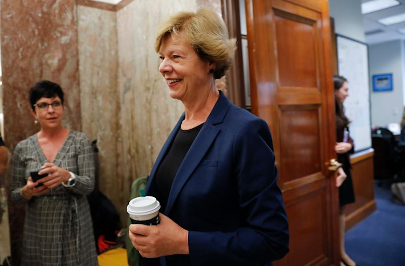 Sen. Tammy Baldwin, D-Wis., walks out of Sen. Susan Collins' office on Capitol Hill in Washington, Monday, Sept. 17, 2018. (AP Photo/Pablo Martinez Monsivais)
