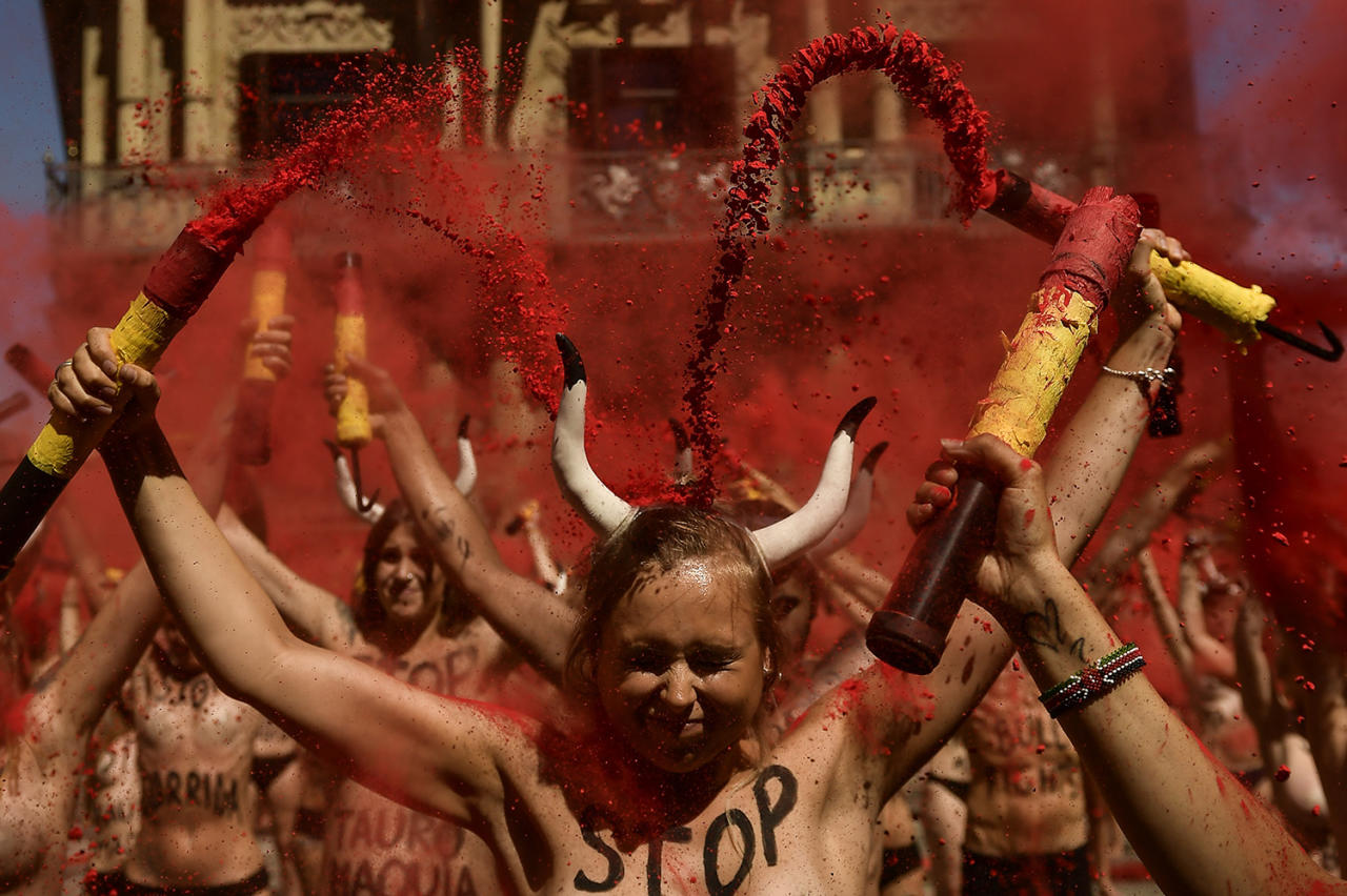 <p>Demonstrators break <em>banderillas</em> with red dust during a protest against bullfighting in front of city hall on July 5, a day before the San Fermín festival in Pamplona. (Photo: Alvaro Barrientos/AP) </p>